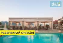 Нощувка на база HB в Ntinas Filoxenia Hotel, Скала Потами, о. Тасос