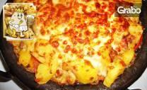 Картофите на царя - с бекон, шунка, лук, топено сирене, сметана,
